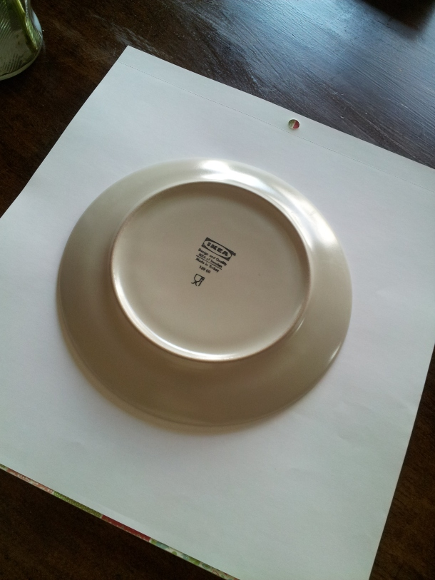 Use a plate to trace a circle